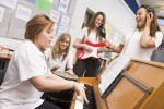 Schoolgirls playing musical instruments in music class